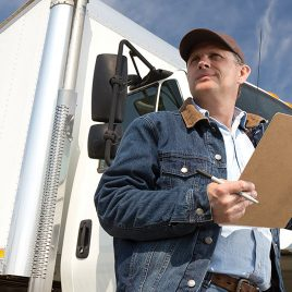 USA Wood Door - Man standing outside of truck with clipboard